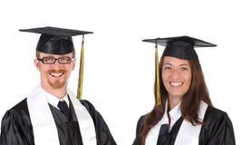 Riuscito allievo due in abiti di graduazione Immagine Stock