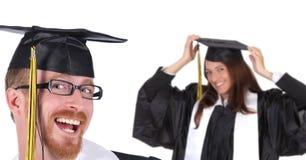 Riuscito allievo due in abiti di graduazione Fotografie Stock