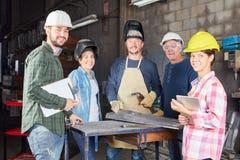 Riuscito artigiano o gruppo di locksmithery immagine stock