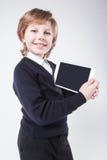 Riuscito giovane con sorridere della lavagna per appunti fotografia stock