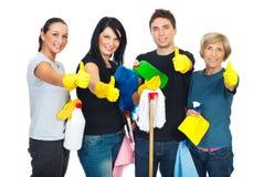 Riuscito lavoro di squadra della gente di pulizia Immagini Stock