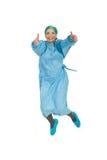 Riuscito salto della donna del chirurgo Fotografia Stock
