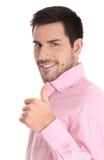 Riuscito uomo d'affari in camicia rosa con il pollice su. Immagini Stock Libere da Diritti