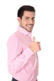 Riuscito uomo d'affari in camicia rosa con il pollice su. Fotografie Stock