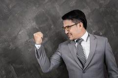Riuscito uomo d'affari che celebra con un braccio su Fotografia Stock Libera da Diritti
