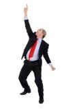 Riuscito uomo di affari che indica la sua barretta Fotografie Stock Libere da Diritti