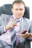 riuscito uomo di affari che tiene telefono mobile Immagine Stock Libera da Diritti
