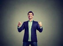 Riuscito uomo di affari che vince celebrando successo Fotografia Stock Libera da Diritti