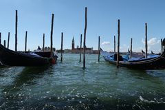 Riva degli Schiavoni - the main promenade of Venice. Gondolas stock photos
