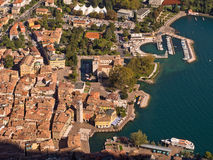 Lake Garda Italy. Aerial view of of the lakeside town Riva del Garda from Monte Oro, showing the red tiled roofs of the old town, the main square and the harbour stock photography