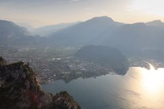 Riva del Garda town panorama at Lake Garda and mountains at sunrise in the morning, Italy Stock Image