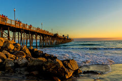 Riva dell'oceano Pier Sunset Immagine Stock