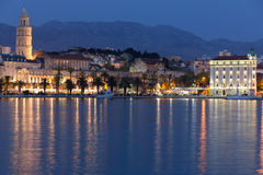Riva promenade at night. Split. Croatia. Seafront. Palace of Diocletian and saint domnius bell tower along the Riva promenade at night. Split. Croatia stock images