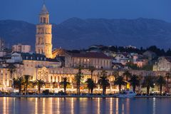 Riva promenade at night. Split. Croatia. Seafront. Palace of Diocletian and saint domnius bell tower along the Riva promenade at night. Split. Croatia royalty free stock photos