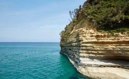 Riva rocciosa, Corfù, Grecia Fotografia Stock Libera da Diritti