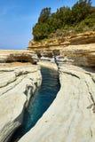 Riva rocciosa, Corfù, Grecia Fotografie Stock