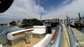 Riva 63 Virtus exhibit at Norwalk boat show 2016. NORWALK- SEPTEMBER 23: Riva 63 Virtus exhibit at Norwalk boat show 2016 in Norwalk, USA on September 25, 2016 stock video footage