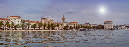 Riva waterfront, houses and Cathedral of Saint Domnius, Dujam, Duje, bell tower Old town by day, Split, Croatia. Daytime panoramic view on Riva waterfront royalty free stock images