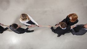 Free Rival Business Man And Woman Compete For The Command By Pulling The Rope Royalty Free Stock Image - 136865106