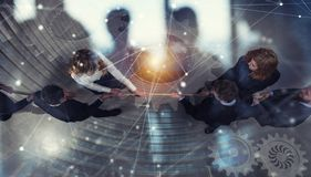 Rival business man and woman compete for the command by pulling the rope. double exposure. Rival business man and woman compete in office for the command by royalty free stock photos