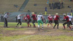 Rival team players using force to tackle opposing ball carrier, violent attack. Stock footage stock video