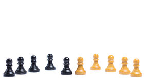 Rivalry. Chess pieces in front of white background - Concept of rivalry Royalty Free Stock Photo