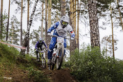 Rivalry between two athletes mountain bikers on track Royalty Free Stock Photo