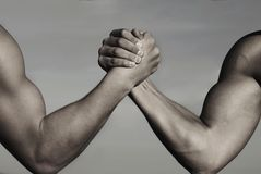 Rivalry, vs, challenge, strength comparison. Two men arm wrestling. Arms wrestling, competition. Rivalry concept - close. Up of male arm wrestling. Leadership royalty free stock image