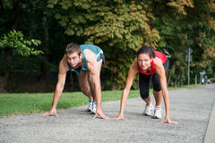 Rivalry - young couple competing in running Stock Image