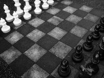 Rivals. Photo of a big chess board royalty free stock photo