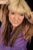 rivande kvinna för ilsket hår Fotografering för Bildbyråer