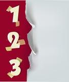 Riven sönder pappers- bakgrund med nummer Fotografering för Bildbyråer