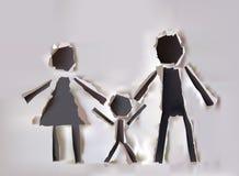 Riven sönder pappers- samling, lycklig förälder och barn Arkivfoto