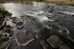 River. Image of a river taken in autumn with a slow shutter speed Royalty Free Stock Photography