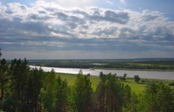 River. View from the hill to the river valley and the forest growing on a hillside Stock Photography