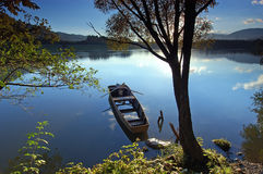 By the river. Old wooden boat on slow river Royalty Free Stock Photo