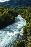 River. Plentiful coming down from the mountain to the lake Panguipulli in the Los Ríos Region Chile Royalty Free Stock Photography