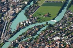 River Aare and houses in Interlaken Stock Photos