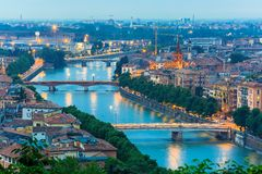 River Adige and bridges in Verona at night, Italy Royalty Free Stock Image