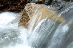 River amongst stone in valley mountains Stock Images