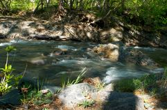 River amongst stone in valley mountains Stock Photos
