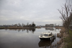 River amstel and small boat in winter not far from Amsterdam Stock Photo