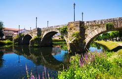 Free River And Old Stone Bridge At Monforte De Lemos Stock Photography - 58169662