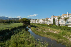 River with apartments. In Marbella with blue sunny sky Royalty Free Stock Photography