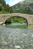 Romanic bridge of Bujaruelo in the region of Aragón in Spain. The river Ara is a river in the northeast of Spain, on the southern slope of the Pyrenees, which Royalty Free Stock Photography