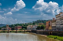 By the river Arno. Beautiful old building by river Arno, in Florence, Tuscany, Italy. Boboli Gardens are in the background stock image