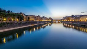 River Arno and famous bridge Ponte Vecchio day to night timelapse after sunset from Ponte alle Grazie in Florence. River Arno and famous bridge Ponte Vecchio day stock video