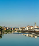 The river arno in Florence. The beautiful city of Florence is reflected in the river Arno in one day with an intense blue color Stock Image