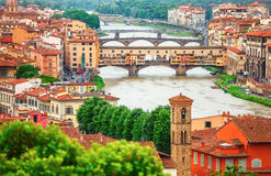 River Arno in Florence with bridge Ponte Vecchio. River Arno Florence with bridge Ponte Vecchio and roofs of old town royalty free stock photography
