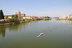 River Arno in Florence. A view of the River Arno in Florence with a couple of rowers on it Royalty Free Stock Images